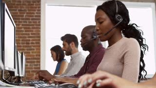 Staff At Desks In Customer Service Department Shot On R3D