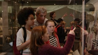 Students Look At Objects In Cases On Museum Trip Shot On R3D
