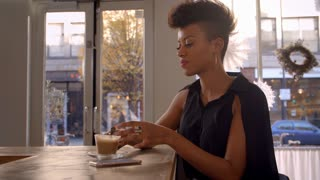 Stylish Woman Connecting With Social Media In Cafe