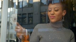 Stylish Woman Sitting In Window Of Bar Using Mobile Phone