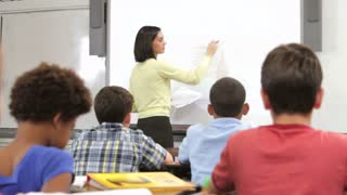Teacher Asking Class Of Pupils Question