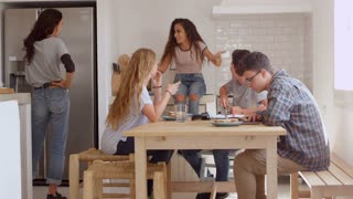 Teenage friends, studying and talking in kitchen, shot on R3D
