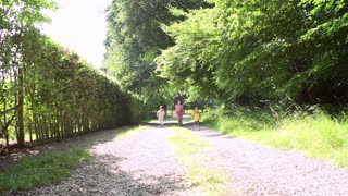 Three Asian Children Running Towards Camera On Summer Path