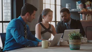 Three Businesspeople Working At Laptops In Caf� Shot On R3D