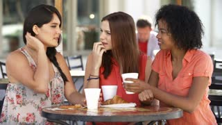 Three Female Friends Meeting In Caf� In Slow Motion