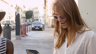 Three female friends read guidebook outside a cafe, Ibiza, shot on R3D