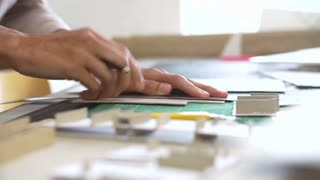 Time Lapse Of Architect Cutting Out Component For Model