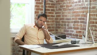 Time Lapse Sequence Of Businessman Working At Desk In Office