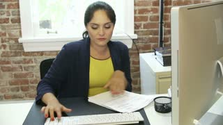 Time Lapse Sequence Of Businesswoman At Desk In Office