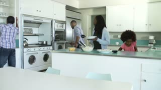 Time Lapse Sequence Of Family Preparing Meal At Home
