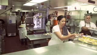 Time Lapse Sequence Of Worker In Kitchen Of Homeless Shelter