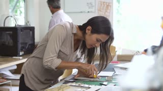Two Architects Making Models In Office Together