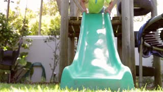 Two Boys Playing On Garden Slide Together