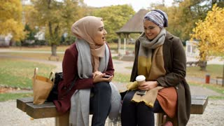 Two British Muslim Women On Lunch Break Meet In Urban Park