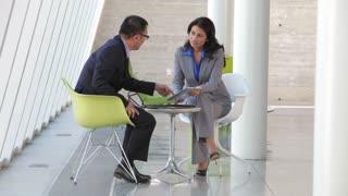 Two Business People Having Informal Meeting