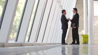 Two Businessman Having Informal Meeting In Office