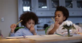 Two Children Doing Homework At Kitchen Table Shot On R3D