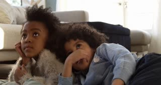 Two Children Watching Television At Home Shot On R3D