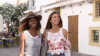 Two female friends walking in the streets of Ibiza, Spain, shot on R3D