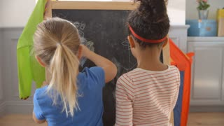 Two Girls Drawing Picture On Blackboard Shot On R3D