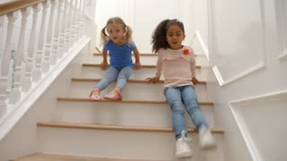 Two Girls Playing On Staircase Shot In Slow Motion