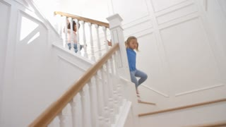 Two Girls Running Down Staircase Shot In Slow Motion