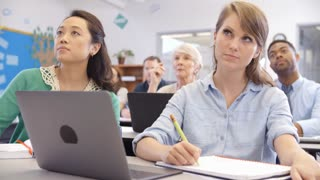 Two mature female students in an adult education class