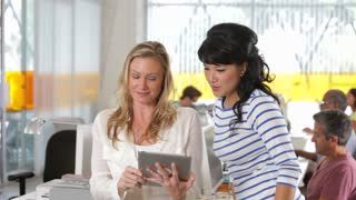 Two Woman With Digital Tablet In Creative Office