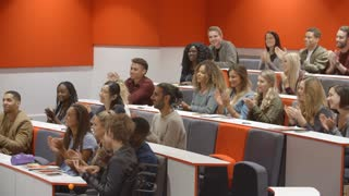 University students applauding at the end of a lecture