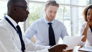 Business Team Having Meeting Around Table In Modern Office