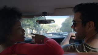 Couple Relaxing In Car During Road Trip