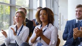 Delegates At Business Conference Applauding Speaker