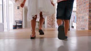 Grandchildren run to greet grandparents as they arrive