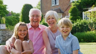 Grandparents and pre-teen grandkids together in the garden