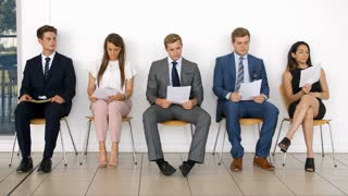 Group Of Job Candidates Waiting For Interview In Office