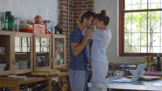 Happy Hispanic couple embracing and dancing in kitchen, shot on R3D