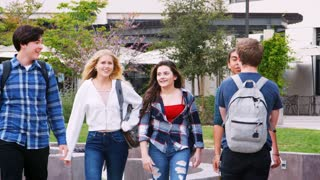 High School Students Socializing Outside College Buildings
