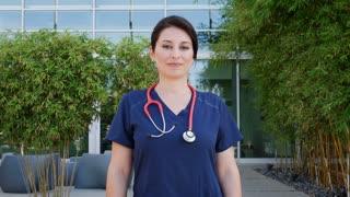 Hispanic female doctor wearing scrubs
