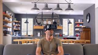 Man Playing Computer Game Wearing Virtual Reality Headset