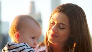 Mother holding young daughter, Manhattan, New York, close up