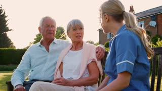 Nurse Talking To Senior Couple In Residential Care Home