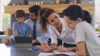 Parents Helping Children With Homework Before Going To Work
