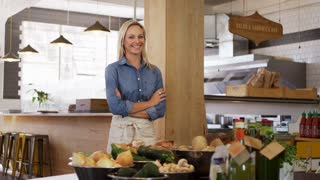 Portrait Of Female Owner In Organic Delicatessen