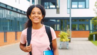 Portrait Of Female Student Standing Outside College Building