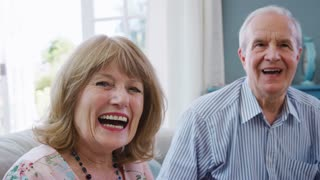 Portrait Of Senior Friends Enjoying Cup Of Tea At Home Together