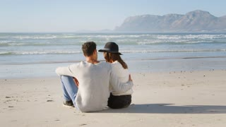 Rear View Of Romantic Couple On Winter Beach Vacation