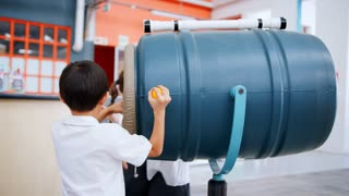 School kids playing with an air cannon at a science centre