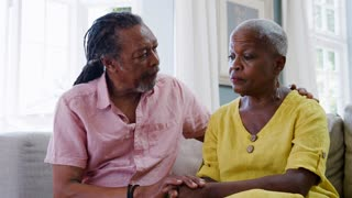 Senior Man Comforting Woman With Depression At Home