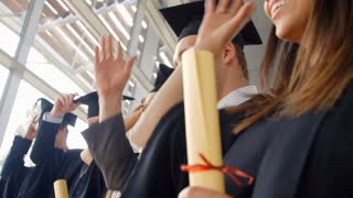 Students At Graduation Ceremony Throwing Hats In The Air