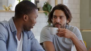 Three Male Friends Meeting In Coffee Shop Shot In Slow Motion